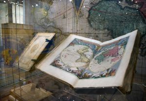 Folio atlas open at a double hemisphere map of the world
