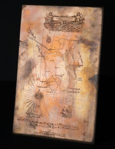 photograph of a copper plate with engraving of Treasure Island map