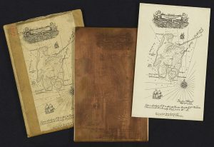 photography showing copper plate with engraving of Robert Louis Stevenson's map of Treasure Island and a print of the map