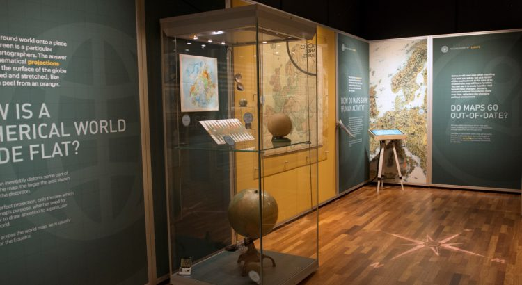 View of an exhibition case containing globes