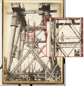 Photograph of the Forth Bridge with detail showing a man among the bridge cantilevers